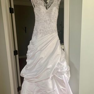 Gorgeous lace beaded wedding gown
